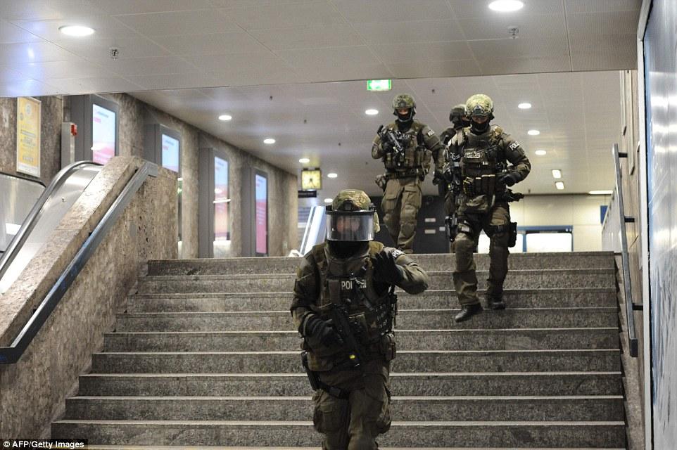 3682C9EE00000578-3703705-Police_walks_inside_a_subway_station_Karlsplatz_Stachus_near_a_s-a-7_1469227700364